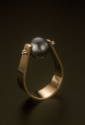 Richard Messina: South seas pearl captured in a gold forged band  with two diamonds
