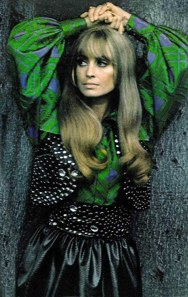 Suzy Kendall by Helmut Newton Vogue 1969 vintage fashion style unique designer model magazine pro photographer color photo print ad late 60s era green puff sleeves blouse blue floral graphic print unique studded vest skirt belt black jeweled to early 70s looks