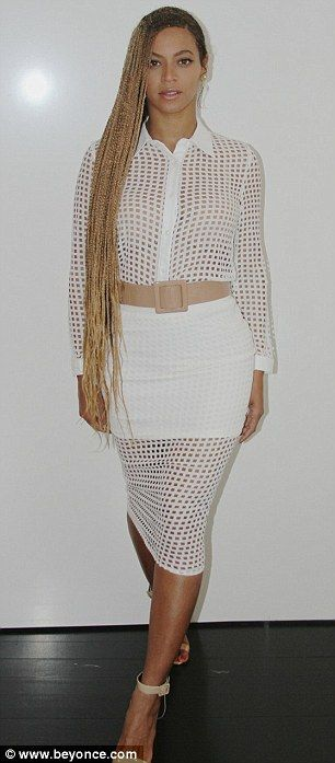 Sultry siren: Beyonce also shared some sexy, leg baring fashions including a white mesh ensemble and a peach maxi dress with thigh-high slit
