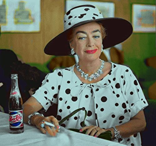 A Pepsi-Cola and a cigarette, what more does Joan Crawford need?!