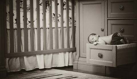 newborn sleeping on the drawer
