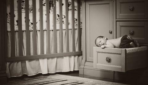 newborn sleeping on the drawer