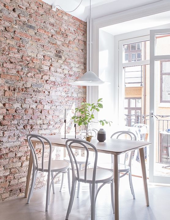 Bright and airy appartment with exposed brick wall and cute dining space @pattonmelo