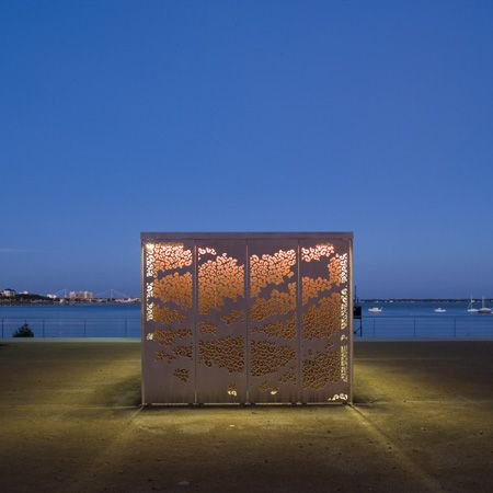 French studio Topos Architecture have completed a pair of perforated fast-food kiosks on the seafront at Saint-Nazaire, France.