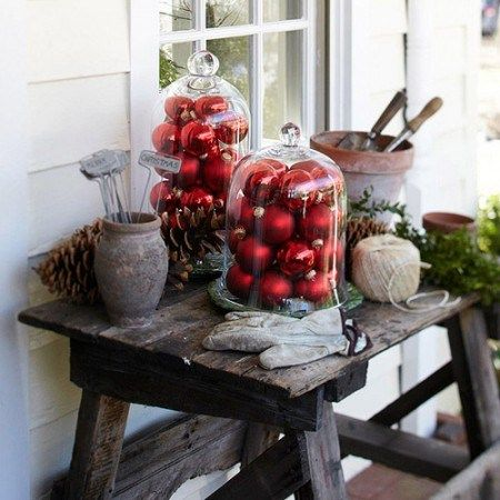 Love cloches! This rustic little display emphasizes how you can decorate inside & outside your home for Christmas. Every time you pass by the bright, bold, red ball ornaments you'll probably be reminded of the fun family times just around the corner. | Garden, Home & Party
