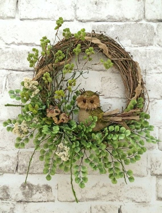 This charming burlap owl wreath was handmade using a grapevine wreath base wrapped with a ribbon of burlap, and adorned with a beautiful arrangement of white flowers, greenery, burlap mushrooms, moss, and a burlap and moss twig owl. This wreath would look amazing displayed on a mantel, wall, or front door. It's perfect for spring, summer, fall, or anytime of year! - ADORABELLA WREATHS!