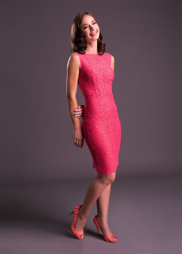 We're obsessed with this #coral reef, fitted #lace #dress! Perfect for a #matricdance or special event. Click to View and Book a Free Fitting.