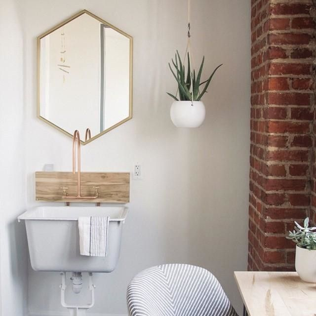 Our friend @becleanshop just opened the doors to her new space at the 52 O Street Studios. We are loving what she did with our Hexagon Wall Mirror but can we just talk about the copper sink faucet for a second?! Her husband made it, guys!!! #acreativedc #mywestelm #madeindc #copper #beclean #dslooking by @pandaheadmorgan