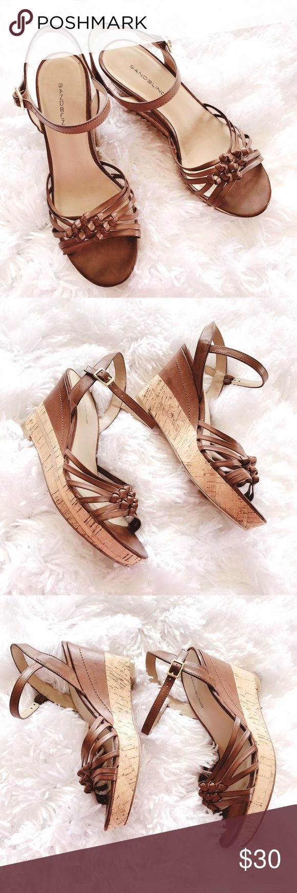 Bandolino Brown Ankle Strap Peep-Toe Wedges Bandolino Brown Ankle Strap Peep-Toe Wedge Sandals.  Heel measurements 3.5 inches.  In excellent condition.  One small scratch on the inside of the shoe but that's it. Bandolino Shoes Wedges