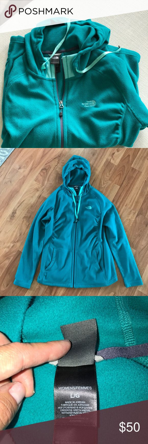 Women's North Face zip up fleece Like new condition, Large women's zip up fleece by The North Face. Color is a turquoise green with mint by the neck and drawstrings. Super warm and soft The North Face Tops Sweatshirts & Hoodies