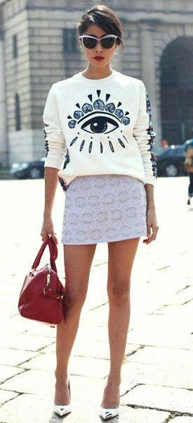 Kenzo eye sweatshirt with mini skirt and large bag for spring fashion outfit