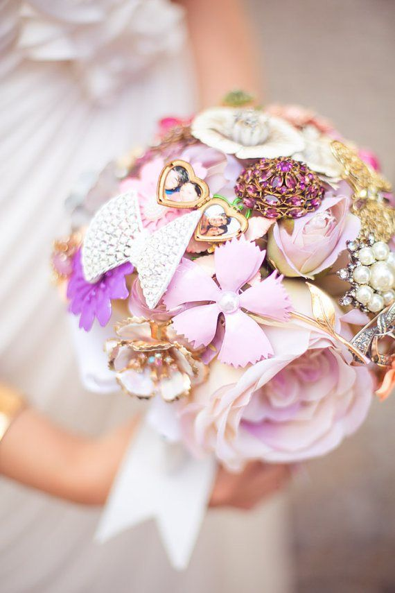 This fun silk and brooch bouquet features a locket with photos inside for your favorite snapshots. Plus, this bouquet lasts forever! By The Ritzy Rose. | http://emmalinebride.com/bride/flower-bouquets-that-last