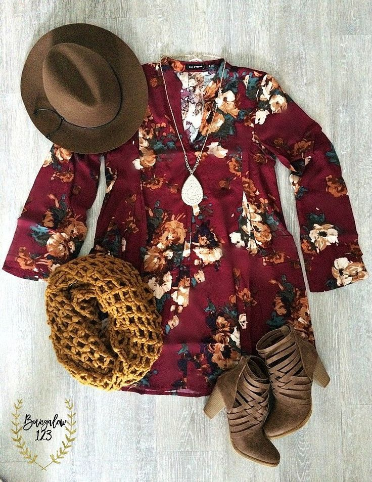 Gorgeous Tunic Top in Deep Wine featuring an allover floral print. V-neck with mandarin collar and slight bell sleeves. Looks great over a pair of our B123 Seamless or Fleece Leggings and Booties for