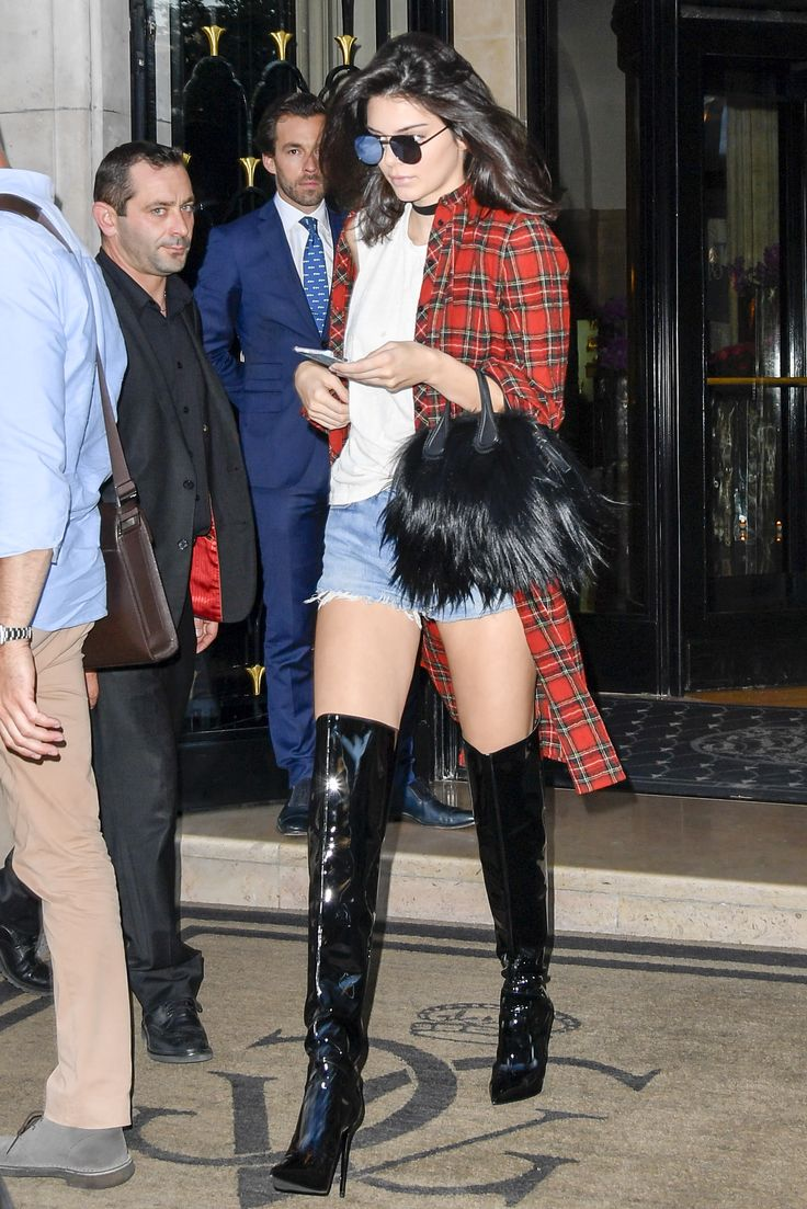 Kendall's Street Style: Wearing a red plaid flannel, white tee and Re/Done shorts with black over-the-knee boots and a fur bag.