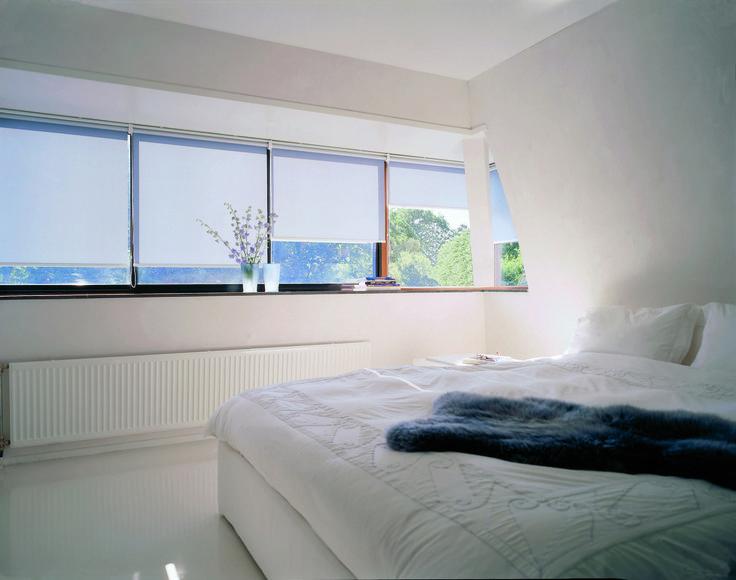 Verosol roller blinds regulate light, heat and comfort in the bedroom.
