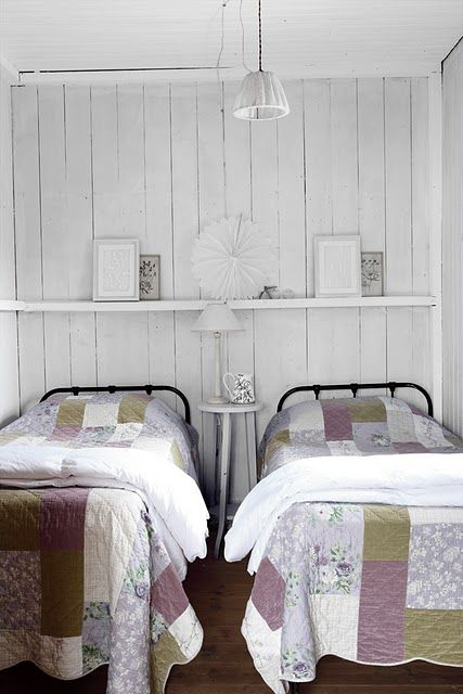 two beds in a small space... Looks more like beach house decor to me.