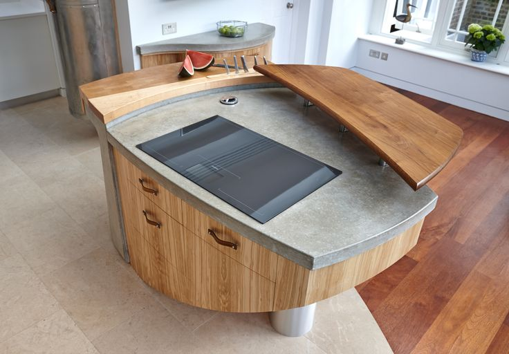 Polished concrete top.  Designed by Johnny Grey