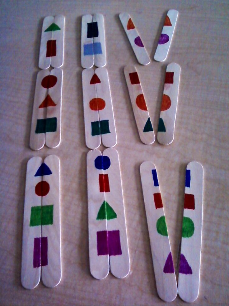 Leveled Shape Matching-jumbo Popsicle sticks. (From top) Level 2 (2 shapes per pair, random colors), Level 3 (3 shapes per pair, same color scheme throughout to demand attention to detail) and Level 4 ( 4 shapes per pair, same color scheme throughout to demand attention to detail). SKILLS: color recognition, shape recognition, matching (could be modified to expose students to patterns). Great for ECI