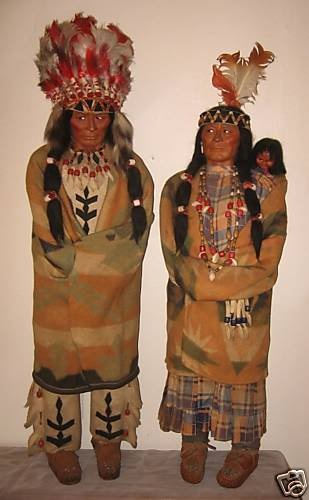 """Skookum pair -- largest size  made 36"""", these with original clothes and headdress and extremely rare."""