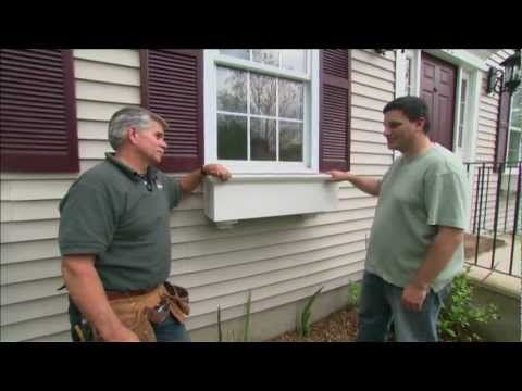 Best video tutorial on how to install window boxes on vinyl siding, add protection and rocks to prevent draining holes from getting plugged, add self watering reservoir and arrange plants.