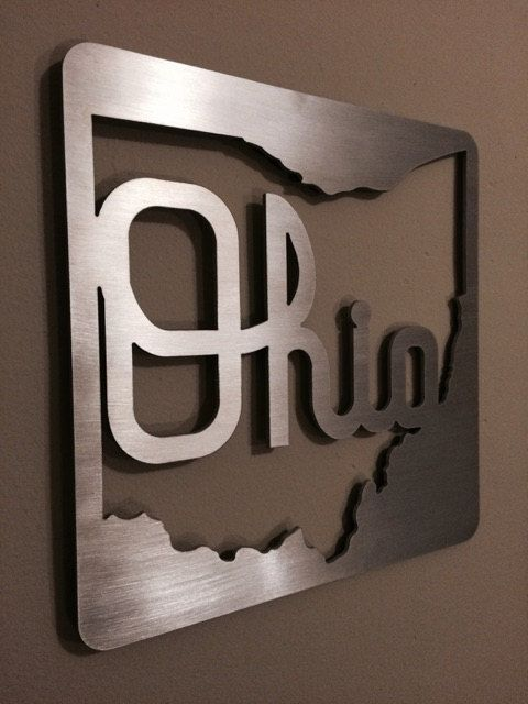 This Script Ohio metal wall decor, made from 1/8 thick aluminum , is a clean-looking, unique way to display Ohio State pride. Each sign is