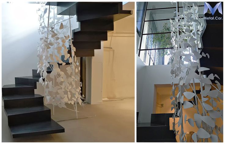 Floating Stairs with decorative Leaves  Scala Sospesa in Ferro Nero cerato con Decorazione di Foglie.