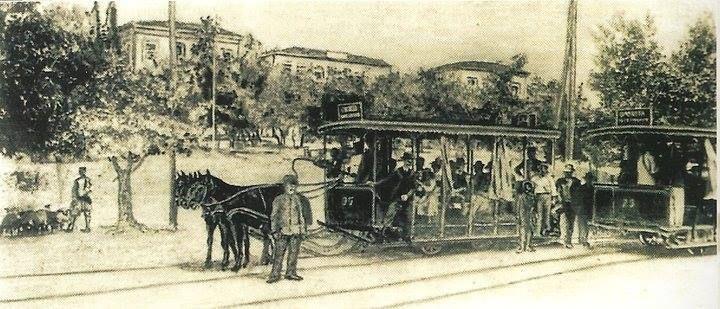 """Ευαγγελισμός 1901. """"Στάση του ιππήλατου τροχιοδρόμου έξω από το Θεραπευτήριο. Χαρακτηριστική φιγούρα ο βοσκός αριστερά"""""""