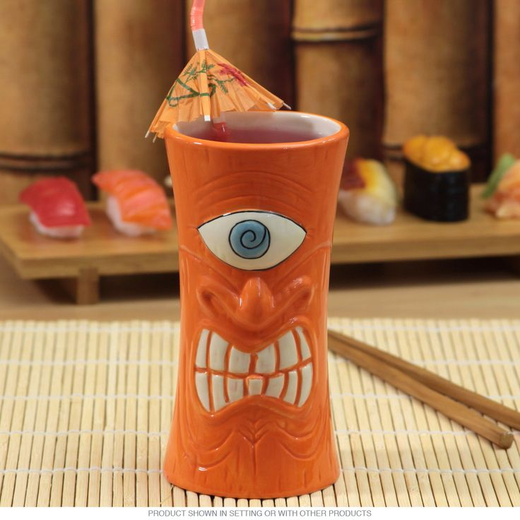 A classic ceramic tiki mug with retro 50s Hawaiian style. This restaurant quality mug sports a glazed glossy finish and is dishwasher safe. With its vintage tiki cup look and fun bar theme, it fits right in with your tiki bar decor. The perfect Hawaiian party mug for your favorite tropical drinks. Measures 2.5