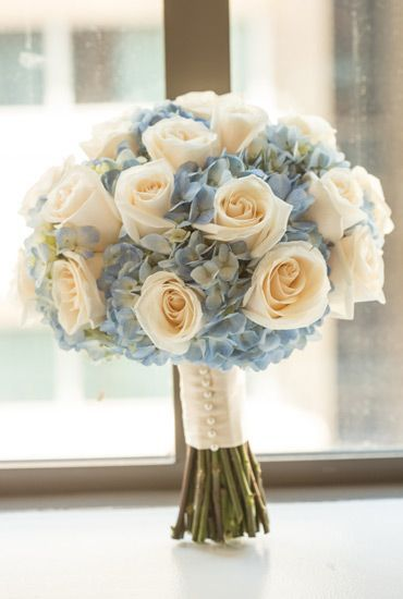 White rose and blue hydrangea wedding bouquet at Kimpton Palomar Philadelphia.
