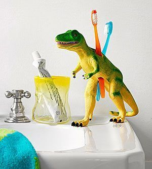 Drill holes into a dinosaur toy (or a toy of your choice) to make a sweet toothbrush holder for the kids