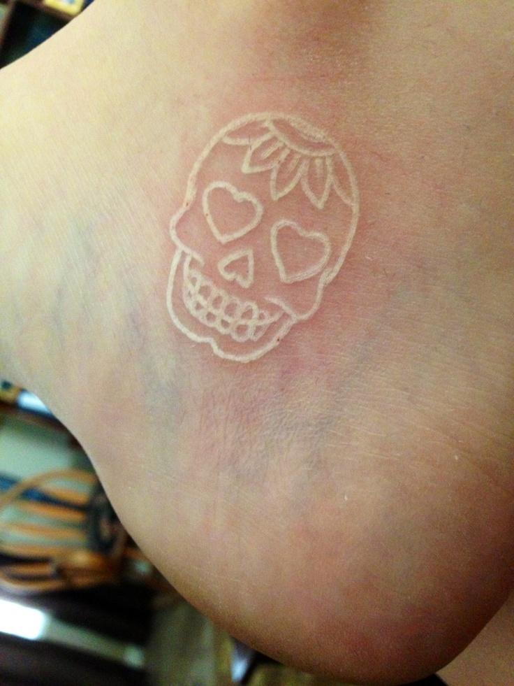 white ink sugar skull simple tattoo