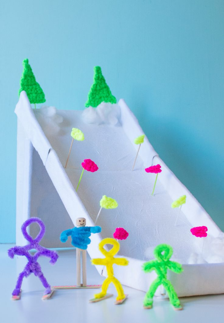 Make a ski holiday play scene out of a cardboard box and pipe cleaner people! Also makes a great game as you can take it into turns to see who can make it down without falling over...