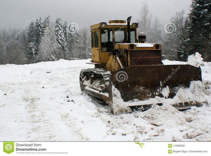 Crawler tractor bulldozer mountain landscape. Photo about snow, crawler, lawn, stands, landscape, road, cold, bulldozer, colors, work, create, related, conditions, mountain - 110900062