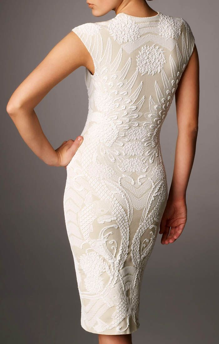 I've become rather fond of white cocktail dresses recently. If I am going to be forced to go to some crappy party, I will totally be the girl that wears a white dress. This is an Alexander McQueen.