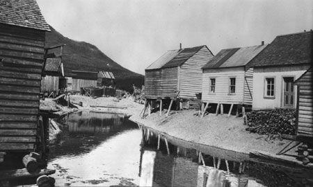 Fishermen's houses in Rivière-au-Renard, Gaspésie, Québec, 1922.
