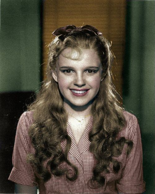 An early costume test for a possible Dorothy Gale costume for Judy Garland. She is shown here in a blonde wig and a country girl look. This costume was one of many conceived and created for the film before the final costume was decided upon.