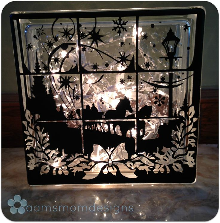 This custom made glass block is approximately eight inches square and features two designs!  Professional grade vinyl looks great, even without the lights (included) turned on!    We've used these in our kids' rooms for a holiday touch just for them (and they make a cool night-light too).  Sh...