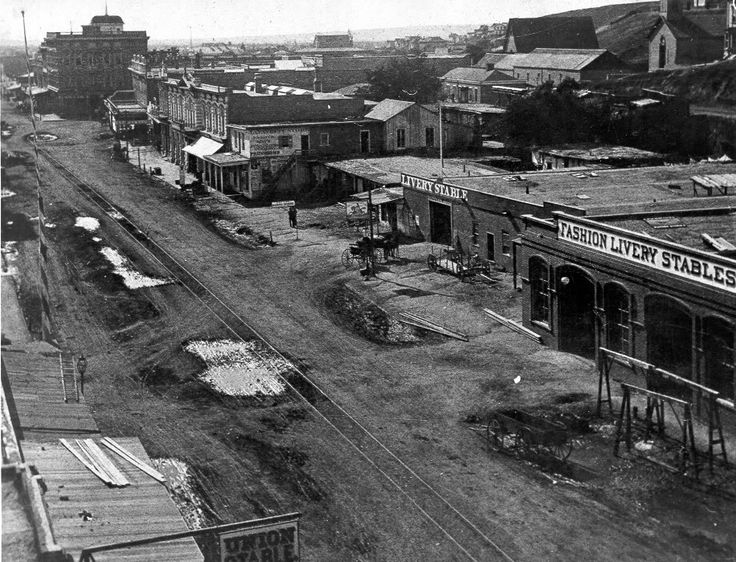 #TodayInCAHistory: On July 3, 1873, the City of Los Angeles passed the first franchise ordinance to D. V. Waldron to construct a public railroad. The result was the L.A. Street Railway, a horse-drawn streetcar system with $0.10 fare. At its height, the system had over 20  lines and 1,250 trolleys, but the rise of car culture during the 1950s reduced public demand for public transportation, ending the system in 1963. (Image: L.A. Street Railway on Main Street, 1875 from  Metro Library…