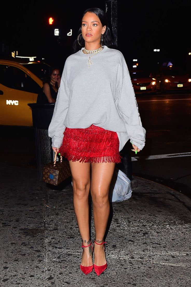 "October 12, 2016  Who: Rihanna  What: A Glam Meets Street Mix  Why: Although we're fond of calling sweatshirt looks ""street-wear"" as a cover-all, the fact is Rihanna's deft mix of glam elements like a gold choker and red fringe skirt with an oversized sweatshirt is a style all her own.   Get the look now: Vetements sweatshirt, $715, barneys.com."