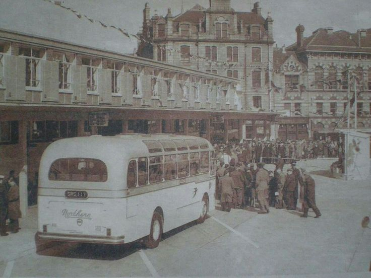 Yellow and cream coloured Bluebird bus at Aberdeen Bus Station on Guild Street.