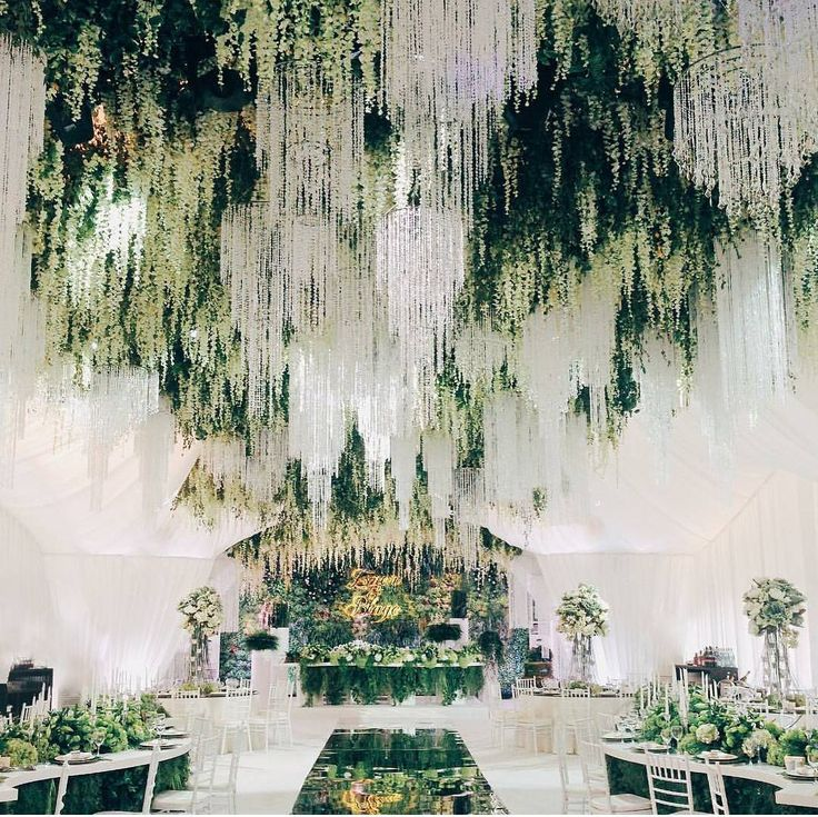 """We are charmed by this enchanted forest theme wedding decoration! Major crush on the incorporation of stunning crystal chandeliers, hanging wisteria and…"""