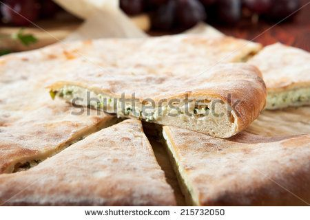http://thumb1.shutterstock.com/display_pic_with_logo/252616/215732050/stock-photo-ossetian-pie-with-cheese-and-herbs-215732050.jpg adresinden görsel.