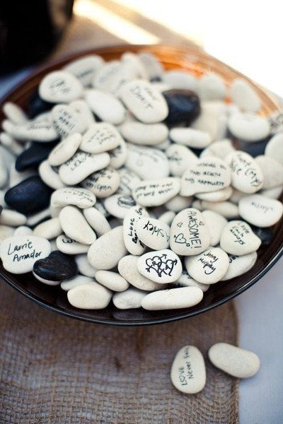 interesting idea for a guest book...sign wishing stones and then can be placed inside home or even in the garden. But spray with an acrylic gloss keeping the stone's message from fading.