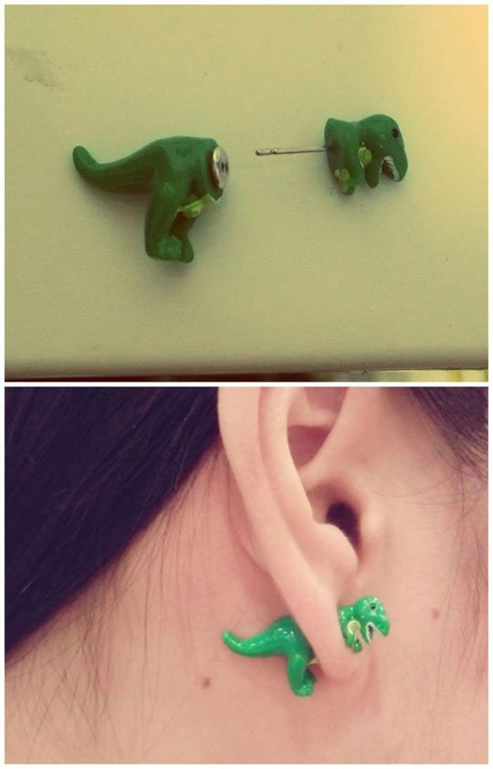 I have seen cat earrings that look like they are resting on your ear.