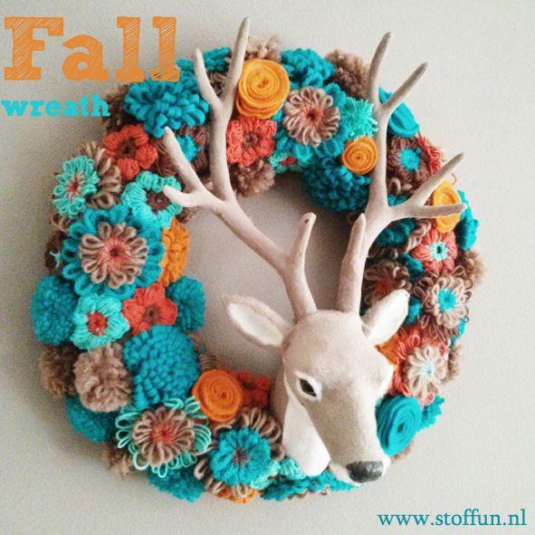 Fall wreath with flowers and pom pom.