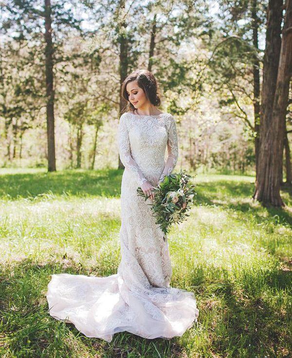 explore long sleeved wedding dresses