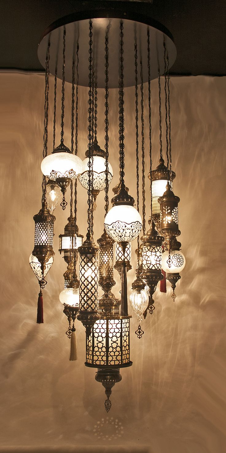 - This outstanding Ottoman Chandelier is Handmade in Turkey by experienced Anatolian Artisan- The chandelier has 21 handmade globes- Materials: Blown Glass and Brass