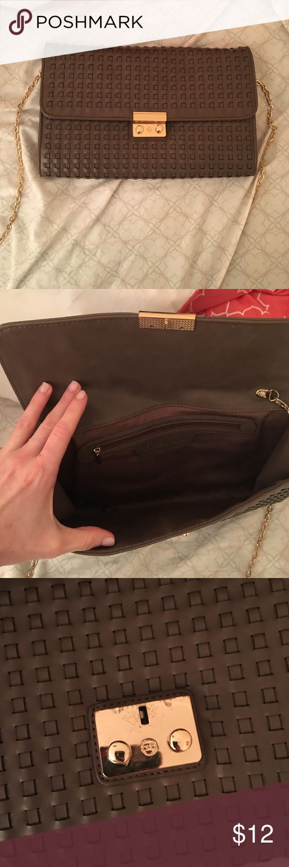 Forever 21 Taupe clutch Forever 21 taupe clutch has been used and scratches on the inside buckle Forever 21 Bags Clutches & Wristlets