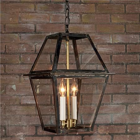 "Richmond Outdoor Hanging Lantern Designed and fabricated in its namesake city of Richmond, this lantern collection has become a traditional favorite. Crafted in darkened copper and glass with brass cluster for an authentic appeal. Made in America. 2x40 watts. (19""Hx11""W) Made in America. 3' chain, 4' wire."