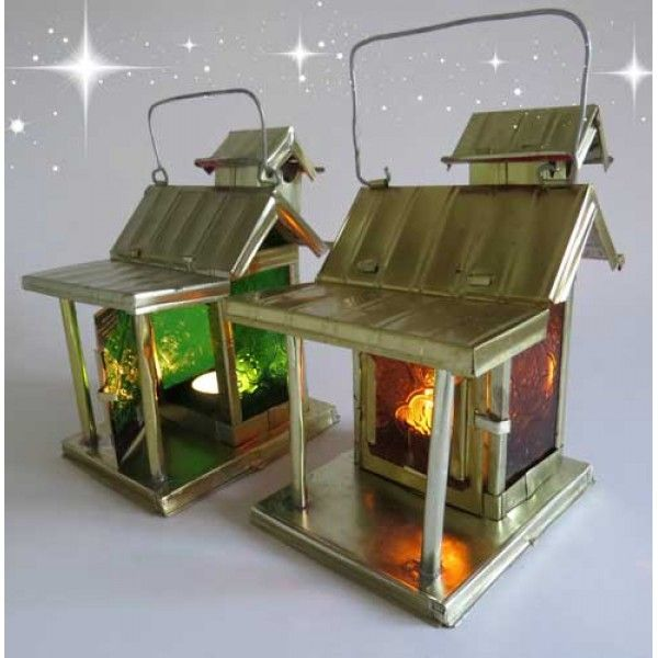Bright and warm at Christmas  - with a Fair Trade lantern handcrafted of scrap glass and recycled metal cans.